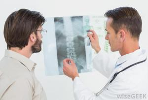 doctor-and-patient-looking-at-spine-xray